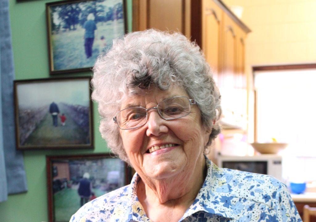 MMHS resident Gwenda Watson is smiling in her kitchen