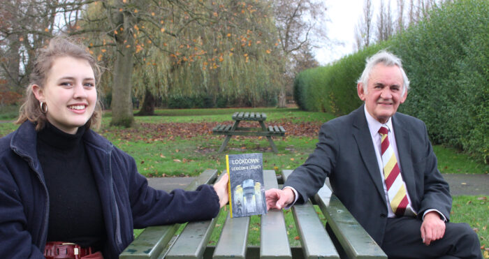 Bob Davies and his granddaughter Emily with a copy of his book about lockdown